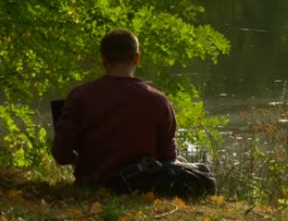 Picture of Man Reading By Stream